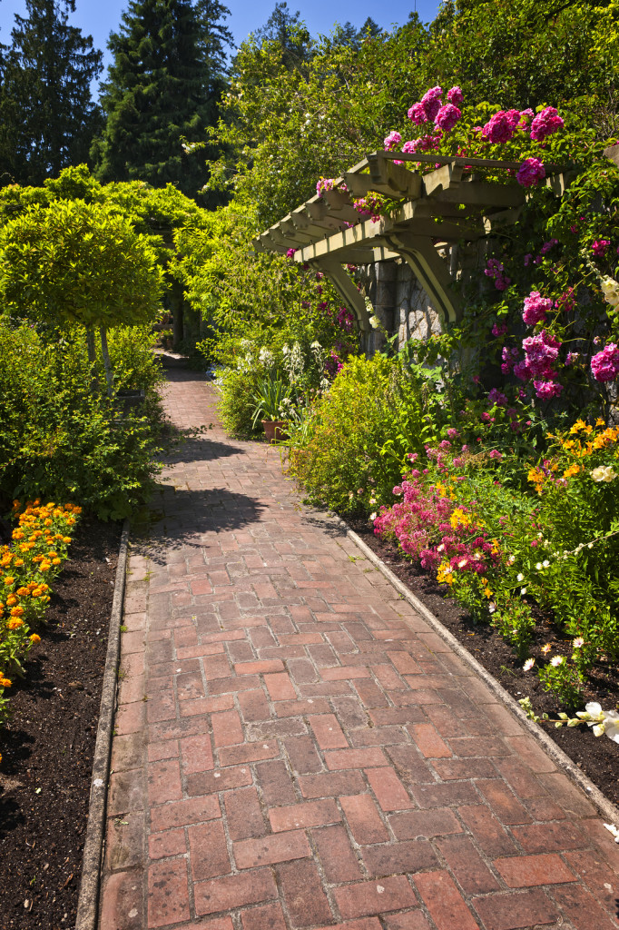 bigstock-Flower-Garden-With-Paved-Path-17817269