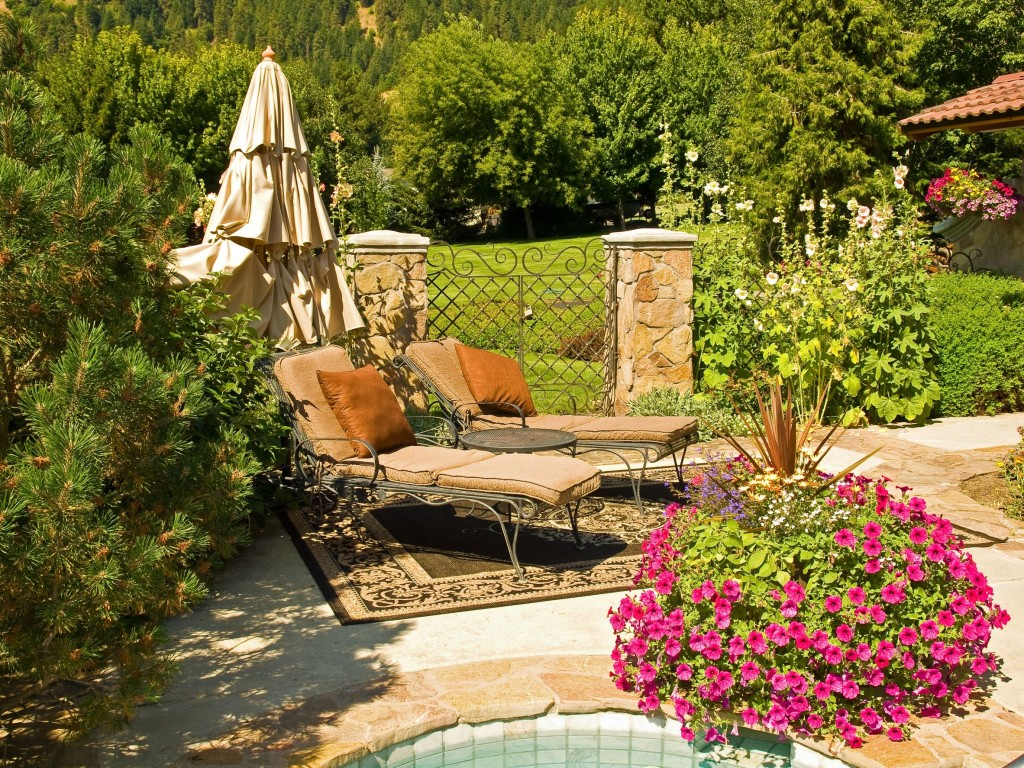 folsom-backyard-hot-tub-hollyhocks-pink-petunia-flowers-fivestar-landscape